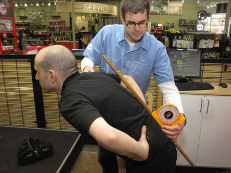 ERIK'S Trufit Bike Fit Specialist measuring a rider's back