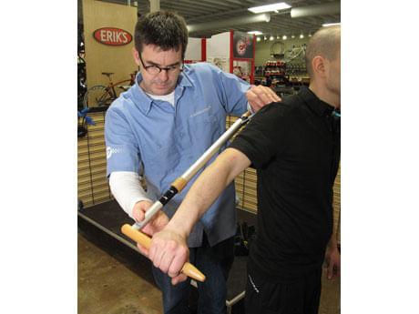 ERIK'S Trufit Bike Fit Specialist measuring length of  rider's arm