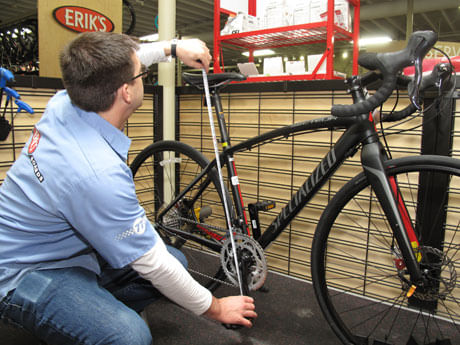ERIK'S Trufit Bike Fit Specialist measuring length of bicycle from ground to handebars