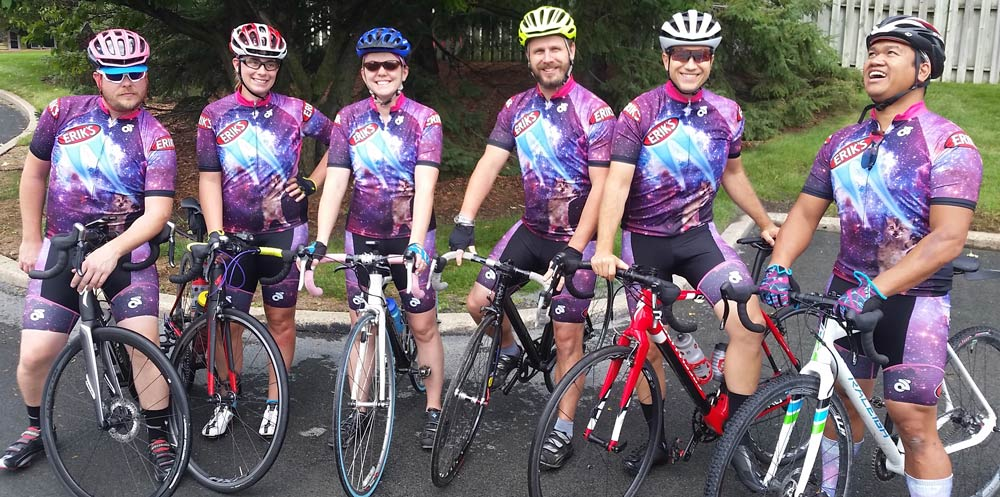 Group of ERIK'S Employees wearing Matching Kits Before a Ride