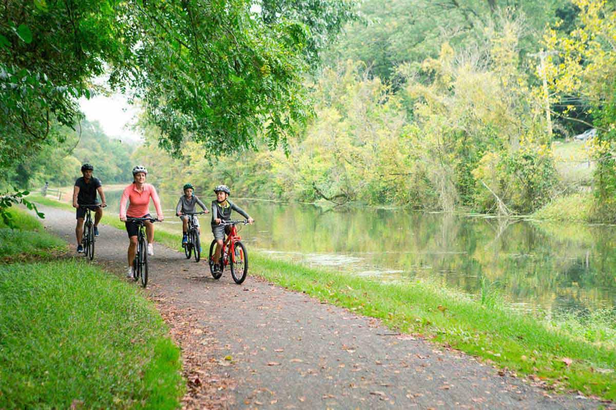 Family Riding Comfot Bikes on a bike path next to a river