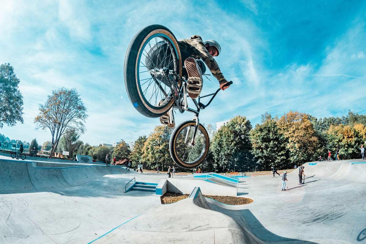 BMX Rider airing over spine jump