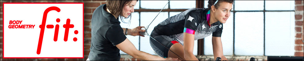 Body Geometry Fit Specialist Woman measuring a woman on a stationary bike with copy overlay