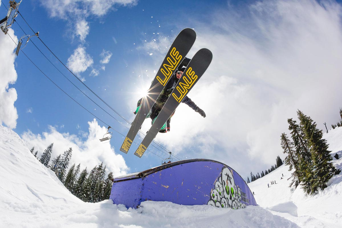 Skier Jumping off the end of an arch grind