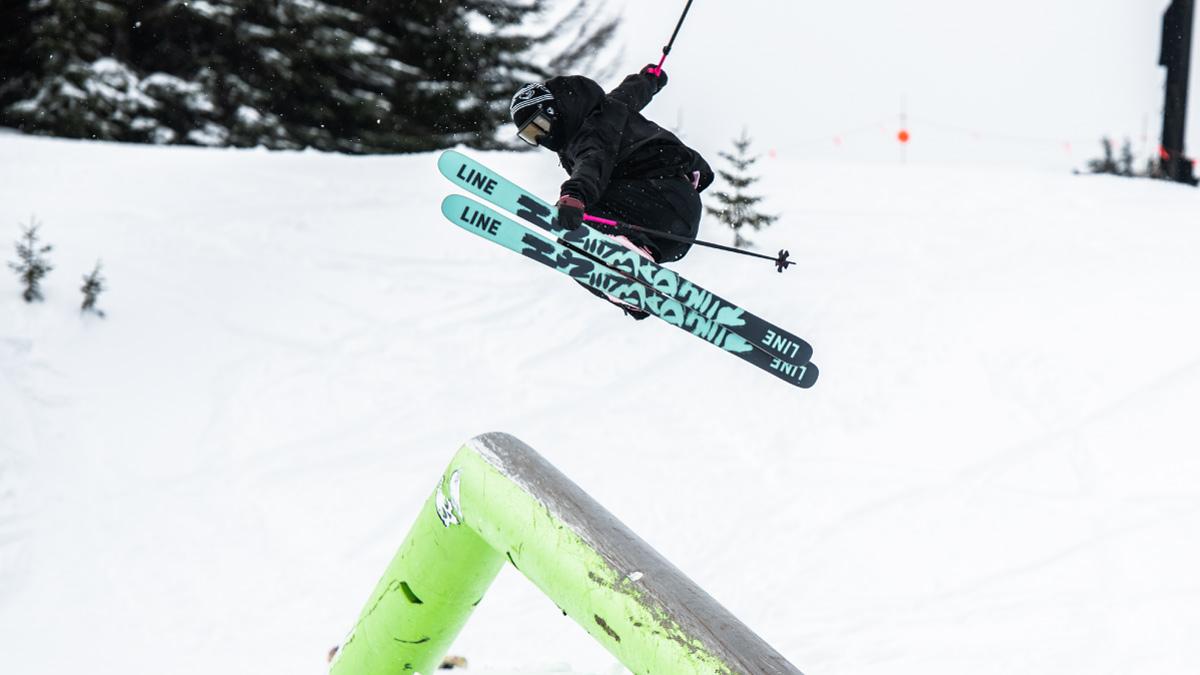 Skier Jumping off pyramid rail